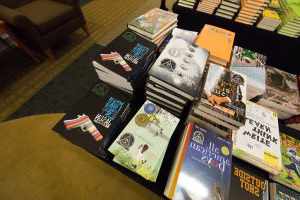 Jason Reynolds' books for sale at 雪兰多大学's 33rd Annual Children's Literature Conference.